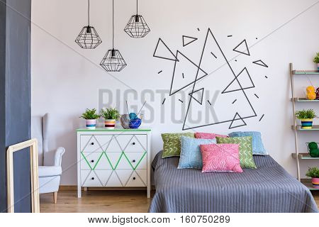 Colorful Bedroom With Rack With Flowers
