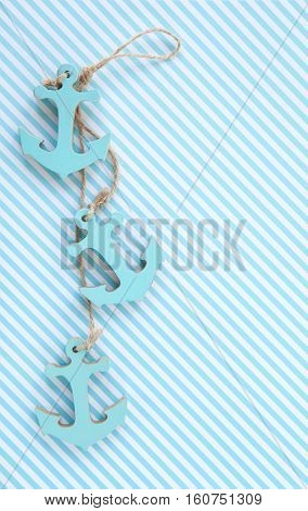 Blue and white striped background with decorative anchors