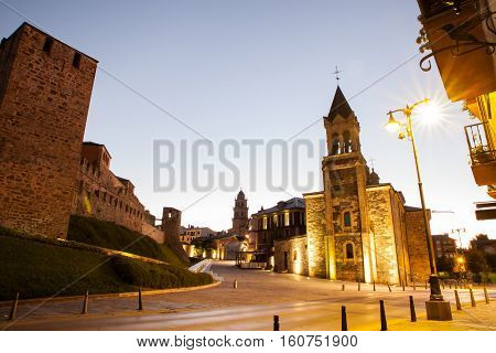 View of the Templar Castle and San Andres church at sunrise in Ponferrada Spain