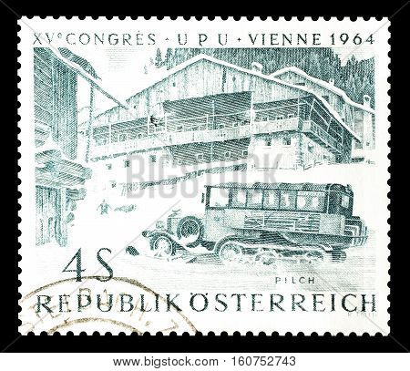 AUSTRIA - CIRCA 1964 : Cancelled stamp printed by Austria, that shows Old snowmobile.