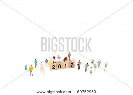 New year concept Crowd of people with Wooden block Word 2017 on white background