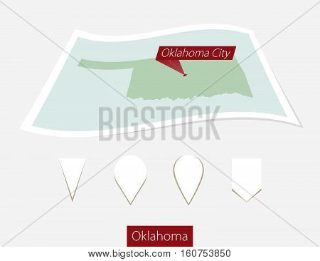 Curved Paper Map Of Oklahoma State With Capital Oklahoma City On Gray Background. Four Different Map