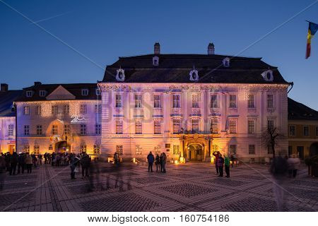 SIBIU ROMANIA - NOVEMBER 26th, 2016 - Brukenthal Museum in Sibiu, a famous baroque building from XVIIIth century in Transylvania Romania, by night in winter with Christmas decoration