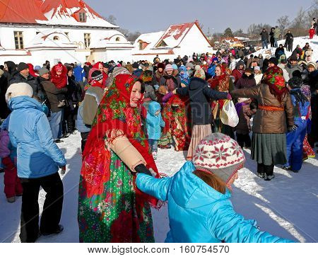 Gatchina, Leningrad region, Russia - March 5, 2011: Maslenitsa. a traditional spring holiday at the Russian peoples. Artists with the audience dance in a circle.