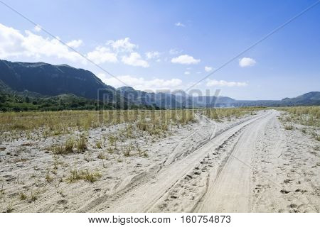 off-road route to mount pinatbo in pampanga in the philippines sandy dirt road leading down crow valley to the volcano