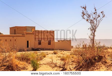 front view on typical moroccan kasbah in desert