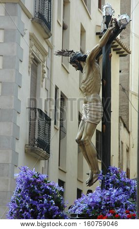 Jesus christ on the cross in procession
