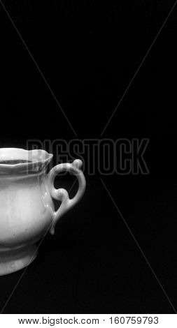 a white cup , a china  cup,  porcelain,  utensils,  a cup on black background