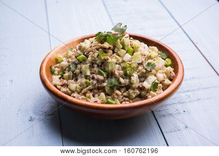 Cucumber  or Cucumis sativus or kakdi chutney or salad or pickle or raita or koshimbir in marathi, favourite side dish mixed with green chilli and crushed peanuts, indian food, selective focus