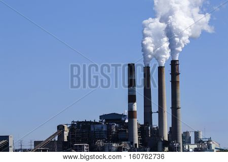 Image of a factory with smoke stacks