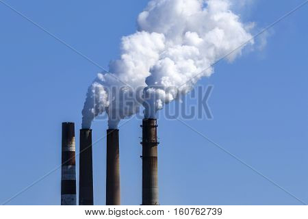 Image of smoke stacks against the sky