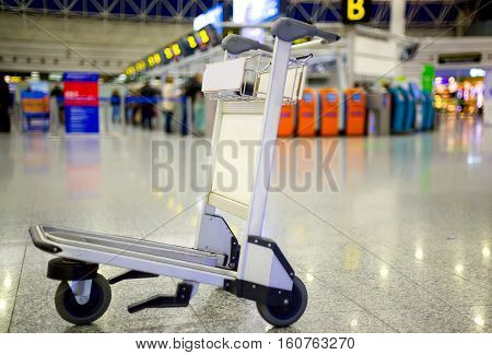 Empty metal cart for luggage standing at airport. Travel concept. Nobody.
