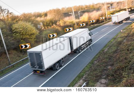 Lorry on the road blurred in motion with focus in the middle of the trailer