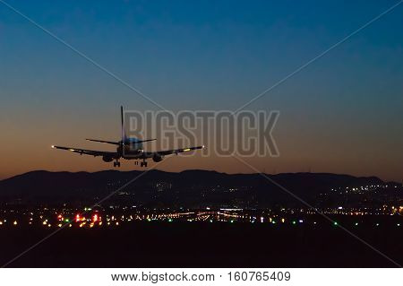 OSAKA, JAPAN - MAY 5, 2015: Boeing airplane landing to the Itami International Airport in Osaka, Japan at dusk.