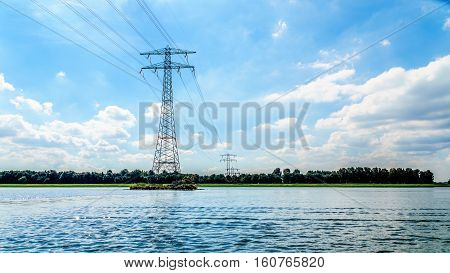 Transmission Lines crossing the Veluwemeer Lake supported by large Transmission Towers in the Netherlands