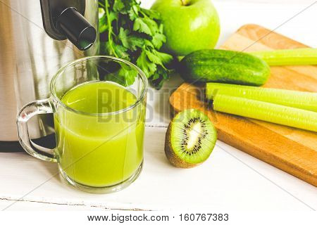 process of preparation of fresh juice in juicer close up