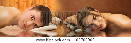 Beautiful couple of lying woman and man in a spa salon with water reflection