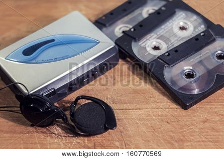 old cassette player with headphones and cassettes