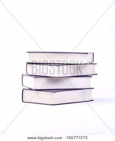 picture of a stack of four new books isolated on white
