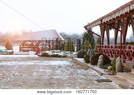 Lithuanian countryside snowy winter. Baltic rustic architecture with wooden houses landscaped Park and restaurant of traditional Lithuanian cuisine Griezpelkiai. Roadside tourist attraction on the route E77 A12. Griezpelkiai Republic of Lithuania European