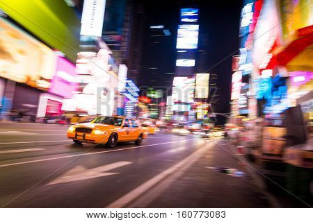 New York City Taxi at Times Square in panning motion, NYC, USA