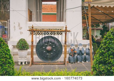 Bangkok, Thailand - January 9 2016: Large vintage nipple gong at a Buddhist temple. It is at Temple of Dawn, Wat Arun, Bangkok, Thailand