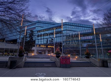 CALGARY, CANADA - NOV 6: Panorama of city hall at sunrise in Calgary on November 6, 2016 in Calgary, Alberta Canada. This building houses city hall. Municpal Plaza is in the foreground.