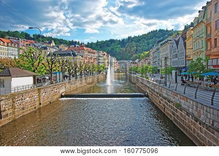 Fountain And Opera House And Promenade Of Karlovy Vary