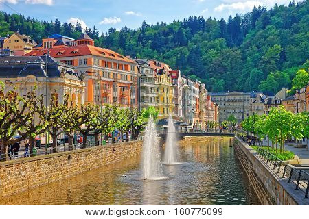 Fountain And Opera House And Promenade In Karlovy Vary