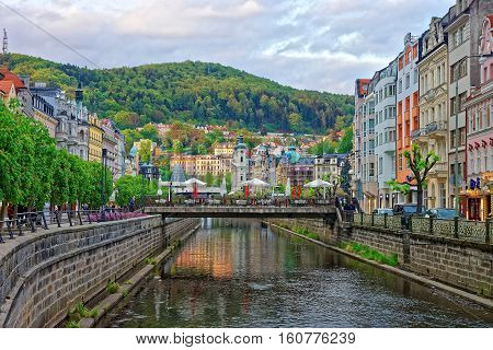 Tepla River And Saint Mary Magdalene Church In Karlovy Vary