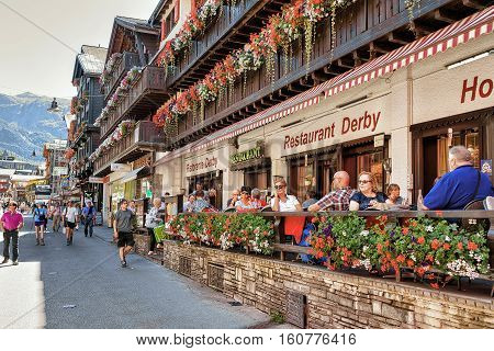 Tourists At Terrace Restaurant In Center In Zermatt