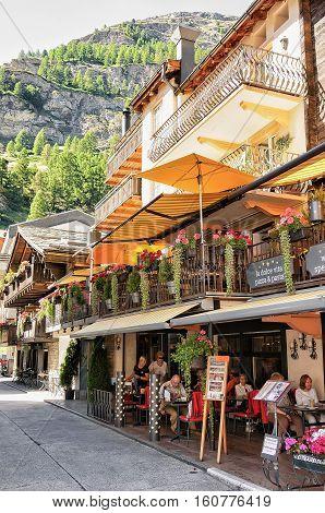Tourists At Terrace Restaurant In Center Zermatt