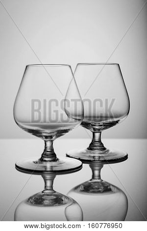 Two empty brandy glasses isolated on white background Empty brandy glass