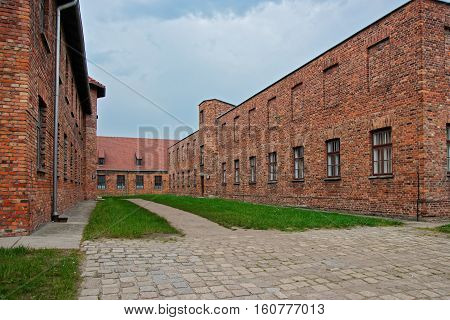 Dormitory with execution yard at Auschwitz concentration camp Poland.