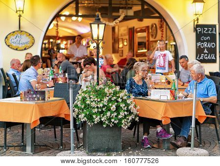People Eating At Street Restaurant In Ascona In Swiss