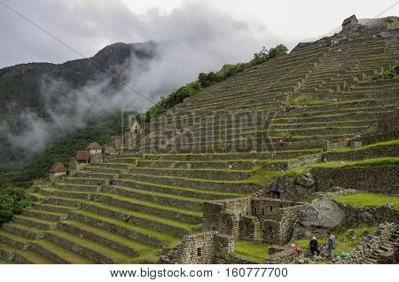 View Of Terraces Of Lost Inca City Of Machu Picchu. Low Clouds. Cusco Region,sacred Valley, Peru