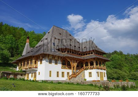 Traditional Wooden House In Barsana Monastery. Maramures Region, Romania