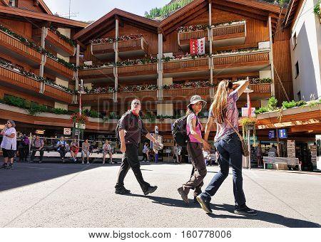 Travelers At Tourist Information Office In City Center Zermatt