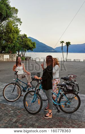Woman Stopped Riding Bicycles For Chatting At Promenade In Ascona