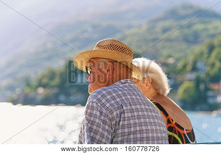Couple Sitting On Bench In Ascona Resort