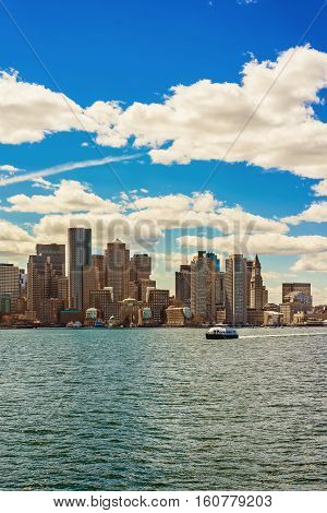 Floating Ferry Boat With The Skyline Of Boston In Background