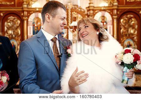 Beautiful newlyweds on wedding ceremony in the church b&w
