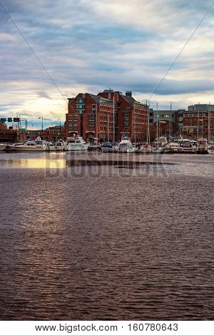 Pier 6 With Sail Boats In Charles River Of Boston
