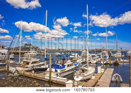 Pier Of Boston Wharf With Sailboats In Charles River
