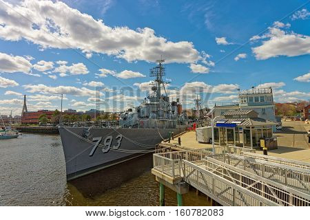 Uss Cassin Young Ship Moored Near Pier In Boston
