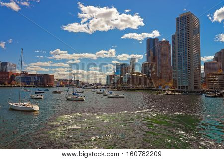 Yachts At Boston Wharf In Charles River And Financial District