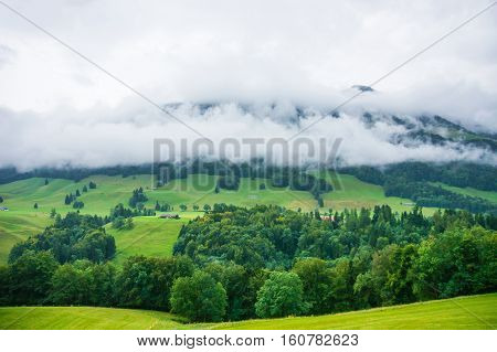 Chalets And Prealps Mountains In Gruyere District In Fribourg Switzerland