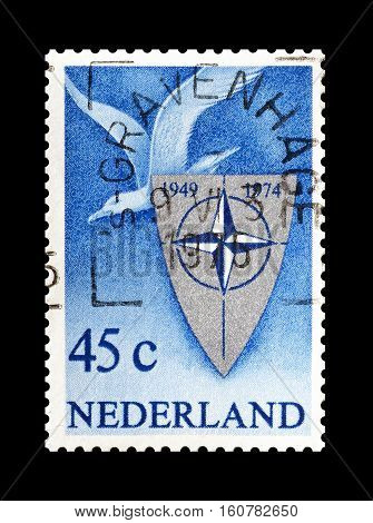 NETHERLANDS - CIRCA 1974 : Cancelled stamp printed by Netherlands, that shows NATO Emblem.