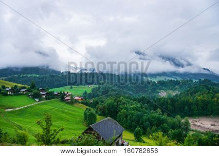 Chalets At Prealps Mountains In Gruyere District In Fribourg Switzerland