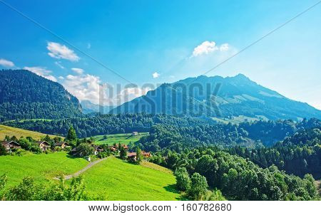 Chalets On Prealps Mountains In Gruyere District In Fribourg Swiss